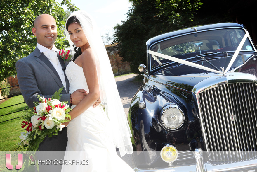 The happy couple with their bridal car